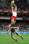 Adam Goodes of the Swans climbs over Jack Redden of the Lions to take a mark during the AFL Round 24 match between the Sydney Swans and the Brisbane Lions at the SCG, Sydney.