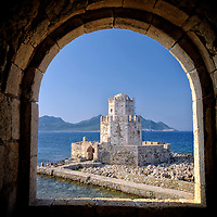 Methoni. Peloponnese. Greece. View of the fairly-tale like octagonal Venetian Bourtzi tower situated on a little islet and joined by a causeway to the 13th century Venetian fortress.
