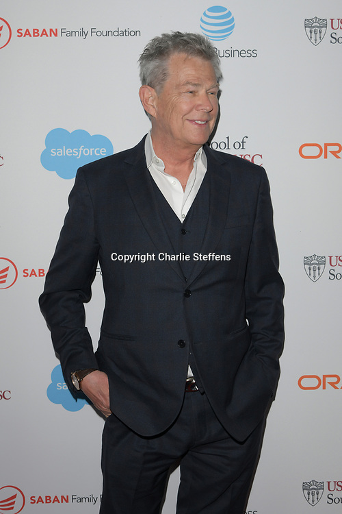 DAVID FOSTER attends the 'Rebels With A Cause'  benefitting the Lawrence J. Ellison Institute for Transformative Medicine of USC at The Water Garden in Santa Monica, California.