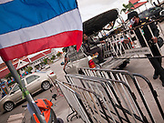 03 JULY 2011 - SAMUT PRAKAN, THAILAND:  Royal Thai Police set up crowd control barriers at a polling place in Samut Prakan, Thailand, Sunday, July 3. More than 47,000,000 Thais were registered to vote in Sunday's election, which had turned into a referendum on the current government, led, by the Thai Democrats and the oppositionPheu Thai party. Pheu Thai is the latest political incarnation of ousted Thai Prime Minister Thaksin Shinawatra. PT is led by his youngest sister, Yingluck Shinawatra, who is the party's candidate for Prime Minister. Exit polling by three Thai polling firms showed Pheu Thai winning a landslide election.      PHOTO BY JACK KURTZ