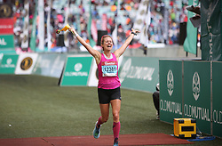 10062018 (Durban) A position 6th  Sophia Sundberg, Sweden run towards the finnish line during the 2018 Comrades marathon in Durban.<br /> Picture: Motshwari Mofokeng/ANA