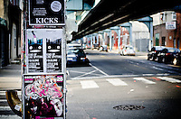 Band flyers posted on a support column for the Market-Frankford Line outside of Kung Fu Nectie in Philadelphia, PA.