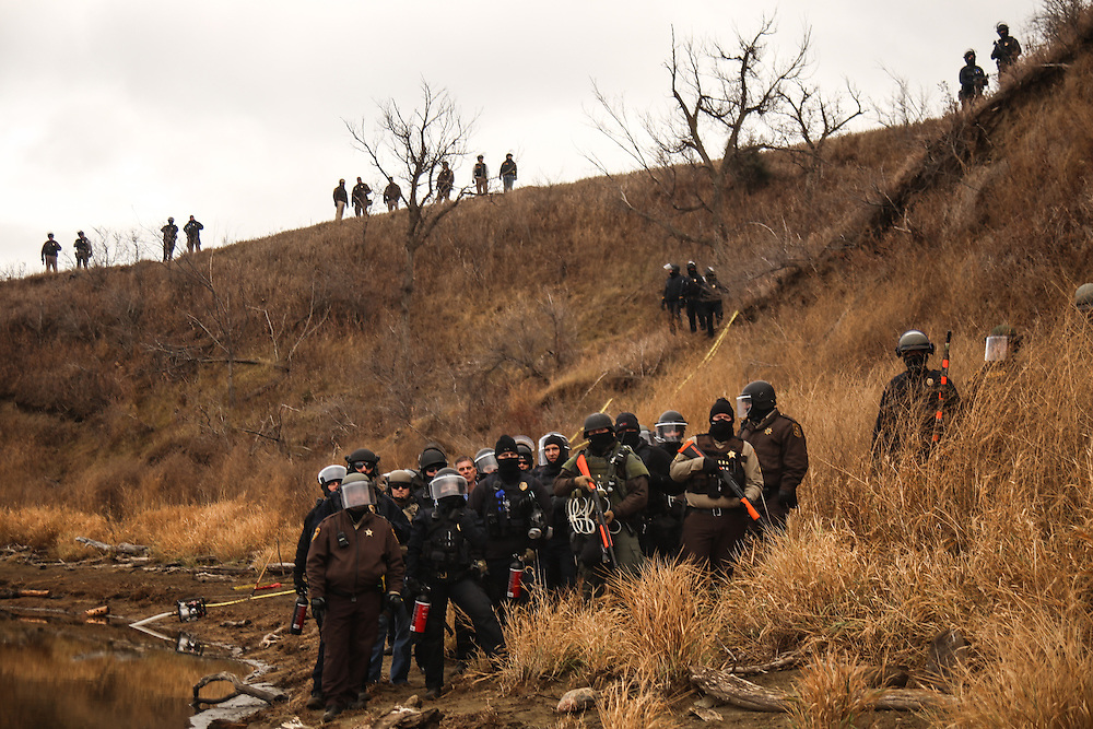 Authorities face protestors as they block them from proceeding further towards the construction site of the Dakota Access Pipeline on Army Corps of Engineers land in Cannon Ball, North Dakota in November 2016.<br /> <br /> According to the Morton County Sheriffs Department, it has received assistance from 24 counties, 16 cities and 9 other states since August 2016. Unarmed protestors, who have been camping on Army Corps of Engineers land bordering the Standing Rock Indian Reservation, have been hit with pepper spray, rubber bullets and water cannons in freezing temperatures by law enforcement.