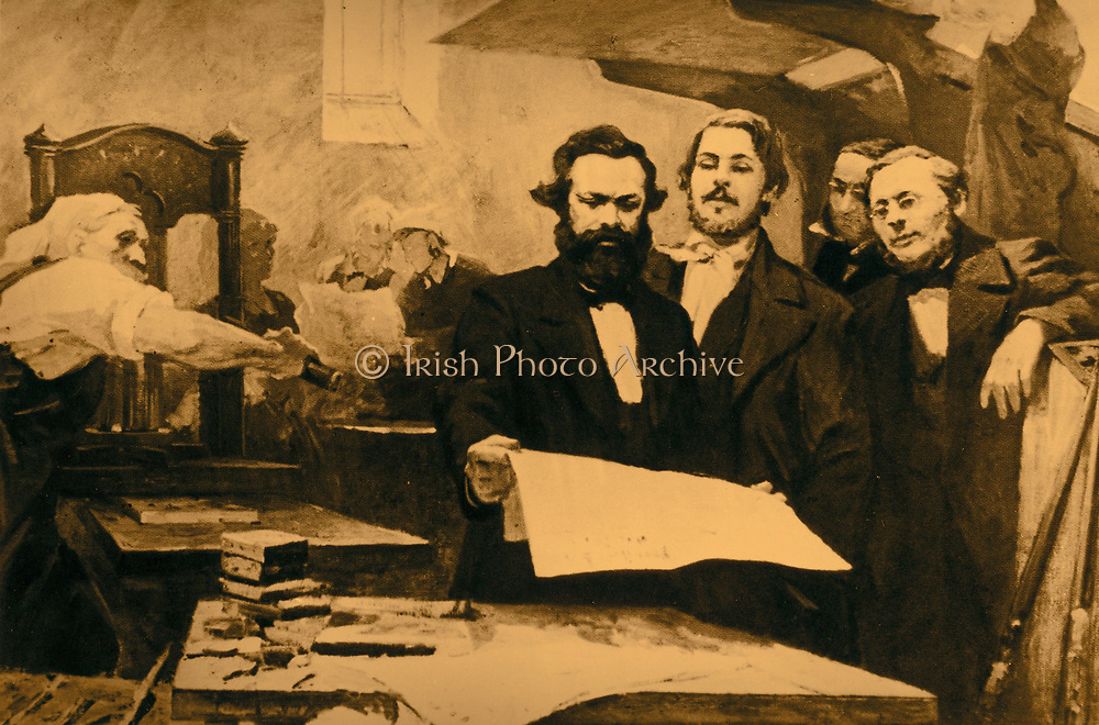 Karl Marx (1818-1883) Father of modern Communism. German political, social and economic theorist. Marx is shown is shown with Engels at the printing of the Communist Manifesto in 1848