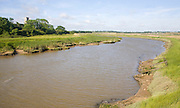 View upstream of levees and flood plain of tidal River Blyth, Blythburgh, Suffolk, England