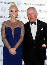 The Prince of Wales with musician Katy Perry, as he attends a reception with the Duchess of Cornwall for supporters of the British Asian Trust at Banqueting House, Whitehall, London.