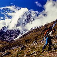 Mountaineer Jay Jensen hikes to ski near Cho La Pass in the Khumbu region of Nepal. 1980.  Mt. Cholatse bkg.