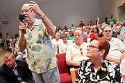 Aug, 25, 2009 -- SUN CITY, AZ: CHARLES CREST, from Sun City, AZ, praises Sen John McCain during the Town Hall meeting on health care sponsored by Sen McCain at Grace Bible Church in Sun City, AZ, Tuesday. More than 1,000 people attended the meeting in the church, which seats 700. Sun City is a staunchly Republican suburb of Phoenix and most of the crowd was opposed to President Obama health care reform efforts.    Photo by Jack Kurtz