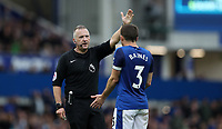 Football - 2017 / 2018 Premier League - Everton vs. Burnley<br /> <br /> Leighton Baines of Everton appeals to referee Jonathan Moss for a penalty at Goodison Park.
