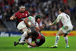 Toulouse flanker Thierry Dusautoir is tackled in possession - Photo mandatory by-line: Patrick Khachfe/JMP - Tel: 07966 386802 - 18/10/2013 - SPORT - RUGBY UNION - Wembley Stadium, London - Saracens v Toulouse - Heineken Cup Round 2.