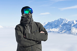 Portrait of a man with covered face with snowcapped mountains in background, Bavaria, Germany, Europe