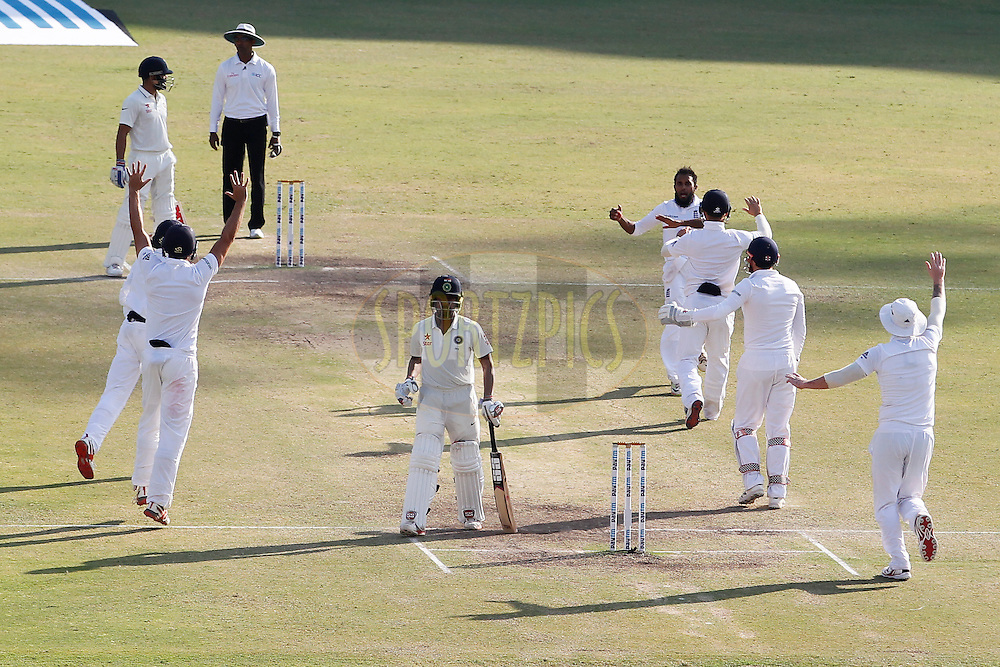 Adil Rashid of England celebrates the wicket of Wriddhiman Saha of India during day 5 of the first test match between India and England held at the Saurashtra Cricket Association Stadium , Rajkot on the 13th November 2016.<br /> <br /> Photo by: Deepak Malik/ BCCI/ SPORTZPICS