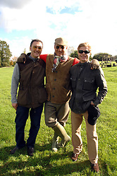 Left to right, LUC ROEG, CHARLES FINCH and ANDREW CONRAD at the Finch & Partners Clay Pigeon Shoot in aid of Battersea Dogs Home at the Holland & Holland Shooting Ground, Ruislip, Middlesex on 17th October 2007.<br />