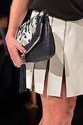 A beaded bag in shades of blue and light gray, shown with details on a short skirt in off-white. By Monika Chiang at Spring 2013 Fashion Week in New York.