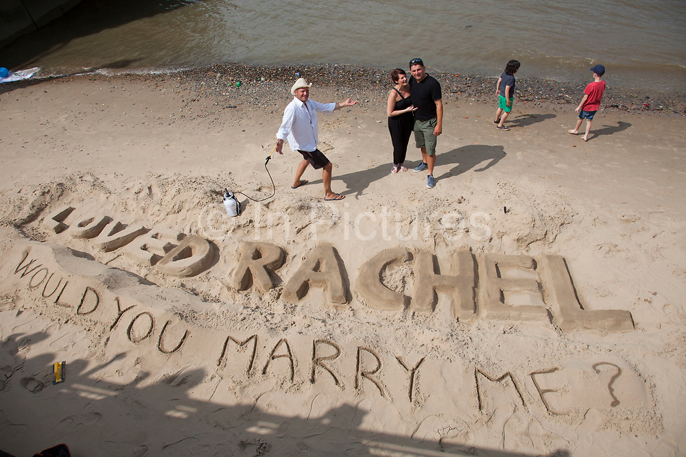 Pat proposes to Rachel on the beach and his proposal is accepted. having employed the talents of a sand sculpter to surprise his girlfrield, the newly engaged couple embrace and kiss. The South Bank is a significant arts and entertainment district, and home to an endless list of activities for Londoners, visitors and tourists alike.
