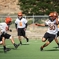Josh Lynch, 18, with the ball after making a catch during Bengal football practice at Gallup High School, Tuesday August 7, 2018.