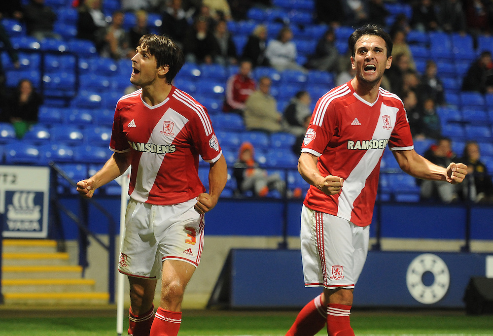 Enrique Garcia Martinez celebrates scoring his sides second goal with team-mate George Friend<br /> <br /> Photographer Stephen White/CameraSport<br /> <br /> Football - The Football League Sky Bet Championship - Bolton Wanderers v Middlesbrough - Tuesday 19th August 2014 - Macron Stadium - Bolton<br /> <br /> © CameraSport - 43 Linden Ave. Countesthorpe. Leicester. England. LE8 5PG - Tel: +44 (0) 116 277 4147 - admin@camerasport.com - www.camerasport.com