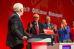 © Hugo Michiels Photography. 23/09/2019. Brighton, UK. Shadow Chancellor of the Exchequer JOHN MCDONNELL (L) gets a thumbs up from party leader Jeremy Corbyn as he speaks at the 2019 Labour Party Conference in Brighton and Hove. Photo credit: Hugo Michiels
