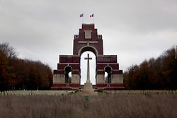 """08 November 2020. Thiepval Memorial, The Somme, France. Remembrance Sunday.<br /> The Thiepval Memorial to the Missing of the Somme is a war memorial to 72,337 missing British and South African servicemen who perished in the Battles of the Somme of the First World War between 1915 and 1918, with no known grave. The visitors' centre opened in 2004. The memorial was designed by Sir Edwin Lutyens and has been described as """"the greatest executed British work of monumental architecture of the twentieth century"""".<br /> On the Portland stone piers are engraved the names of over 72,000 men who were lost in the Somme battles between July 1915 and March 1918<br /> Photo©; Charlie Varley/varleypix.com"""