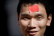 A young man has pasted a Chinese flag on to his forehead to celebrate the Olympic torch relay in his hometown in the southern Chinese town of Longyan in Fujian Province.