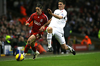 Photo: Paul Greenwood/Sportsbeat Images.<br />Liverpool v Bolton Wanderers. The FA Barclays Premiership. 02/12/2007.<br />Liverpool's Fernando Torres, (L) and Bolton's Lubomir Michalik compete for the ball