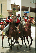 """Cavalcata Sarda, Sassari, Sardinia..neg In Sardinia there are more than 200 festivals and events during the year, but only 3 offer the opportunità to see united, un the same place, all the traditional customs of the isle: Sant'Efisio at Cagliari, the Redentore at Nuoro and the Cavalcata Sarda at Sassari.<br /> The Cavalcata, that is different from the other two celebration because it's not a religious celebration, it join varoius aspects of celebration: there is the presentation of the customs then there is one component more sportive with skills by the riders (""""pariglie""""), elements typically of folk-lore: songs and dances tha last until late hour."""