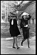 Kate Chancellor and the hon Clare Mosley holding onto their hats while arriving for the marriage of Lady Anne Somerset to Matthew Carr. Badminton. 26 March 1988. Film 88232f6<br /> © Copyright Photograph by Dafydd Jones<br /> 66 Stockwell Park Rd. London SW9 0DA<br /> Tel 0171 733 0108