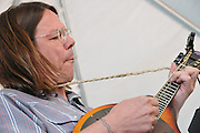 Robby Roberson plays mandolin during Eb's Camp Cookin' concert at 2011 Tucson Folk Festival.