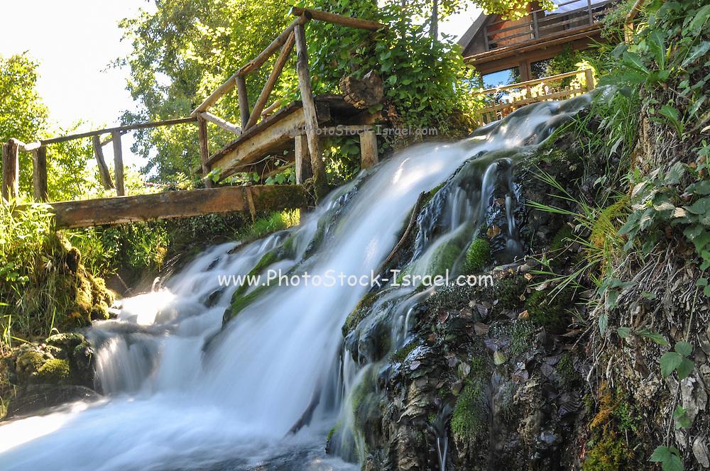 Natural waterfalls and and wooden bridge photographed at Rastoke, Slunj, Croatia