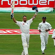 England's captain Nasser Hussain makes his century against India.