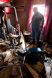 04 Oct, 2005. New Orleans, Louisiana. Hurricane Katrina aftermath.<br /> Tinsley Sammons retrieves the little he can from his home severely mouldy home in the Arabi neighbourhood after the devastating floods which filled his house to the ceiling with water and toxic mud.<br /> Photo; ©Charlie Varley/varleypix.com