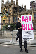 A Kill the Bill activist holds a sign in front of the House of Commons during a protest against the Police, Crime, Sentencing and Courts PCSC Bill 2021 as MPs consider amendments to the Bill inside Parliament on 5th July 2021 in London, United Kingdom. The PCSC Bill would grant the police a range of new discretionary powers to shut down protests, including the ability to impose conditions on any protest deemed to be disruptive to the local community, wider stop and search powers and sentences of up to 10 years in prison for damaging memorials.