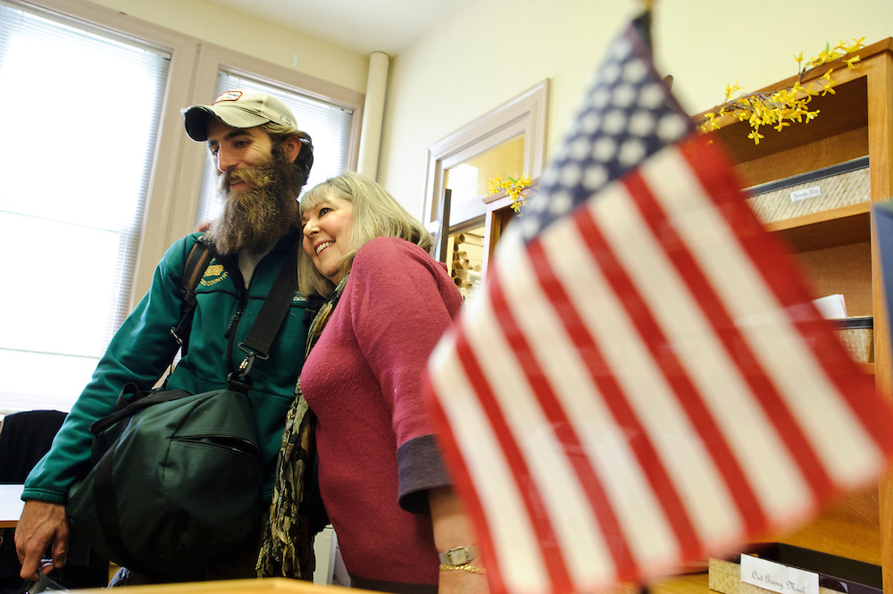 photo by Matt Roth.Wednesday, April 11, 2012..Rose Blizzard the Coordinator of Records and Veterans Affairs Certifying Official for McDaniel College's registration office, Hugs Ron Shriver. She works closely with Ron Shriver and other enrolled veterans at the college to make sure they receive benefits and their checks from the G.I. Bill. ..Ron Shriver is a retired marine staff sergeant. He is also the first in his family to attend college, thanks to the New G.I. Bill. His wife, a fellow retired Marine, is finishing up graduate school in Alaska. After Ron gets his undergraduate degree from McDaniel College in May, he plans to drive to Alaska with is two children Rory, 6, and Miles, 5. For the move Ron got rid of most of his family's belongings, and after his lease was up, he and his children moved back into his parent's farmhouse.
