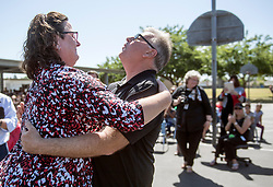 May 2, 2017 - Westminster, California, USA - Carlos Primiani celebrates his surprise 2018 Teacher of the Year award with principal Kim Kroyer at Leo Carrillo Elementary School in Westminster, California, on Tuesday, May 2, 2017. ..Primiani, a 6th grade teacher at Leo Carrillo Elementary School, is one of six teachers who were surprised with the honor by county superintendent of school Dr. Al Mija?res. ..(Photo by Jeff Gritchen, Orange County Register/SCNG) (Credit Image: © Jeff Gritchen, Jeff Gritchen/The Orange County Register via ZUMA Wire)