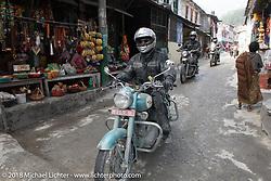 Jonathan Pite passing through Modibeni on Day-7 of our Himalayan Heroes adventure riding from Tatopani to Pokhara, Nepal. Monday, November 12, 2018. Photography ©2018 Michael Lichter.