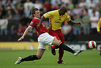 Photo: Lee Earle.<br /> Watford v Manchester United. The Barclays Premiership. 26/08/2006. United's Michael Carrick (L) battles with Damien Francis.
