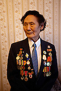 A Yakutian war veteran proudly posing with his medals and decorations. Yakutsk is a city in the Russian Far East, located about 4° (450 kilometres) south of the Arctic Circle. It is the capital of the Sakha (Yakutia) Republic in Russia with a major port on the Lena River. The city has a population of 264.000 (2009). Yakutsk is one of the coldest cities on Earth. The average monthly winter temperature in January is around -43,2 °C. Yakutsk, Jakutsk, Yakutia, Russian Federation, Russia, RUS, 15.01.2010.