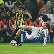 Fenerbahce's Mehmet TOPUZ (L) and Besiktas's Serdar OZKAN (R) during their Turkish superleague soccer derby match Fenerbahce between Besiktas at Sukru Saracaoglu stadium in Istanbul Turkey on Sunday 18 April 2010. Photo by TURKPIX