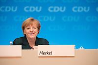 09 DEC 2014, KOELN/GERMANY:<br /> Angela Merkel, CDU, Bundeskanzlerin, CDU Bundesparteitag, Messe Koeln<br /> IMAGE: 20141209-01-154<br /> KEYWORDS: Party Congress, lacht, freundlich