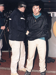 Metropolitan Police photograph of officers leading away Aldo Ciarrocchi, 32, following an abortive raid on the Millennium Dome Novermber 2000.   Ciarrocchi was one of four men who were found guilty by a jury, at the Old Bailey in London.  * ... of plotting to carry out the robbery of the millennium by snatching 200 million worth of diamonds from the Dome. A fifth man was cleared of conspiracy to rob but found guilty of conspiracy to steal the diamonds