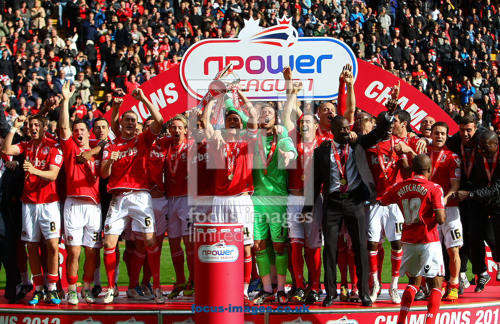 Picture by John Rainford/Focus Images Ltd. 07506 538356.05/05/12.Johnnie Jackson of Charlton Athletic lifts the Npower League 1 trophy at The Valley stadium, London.