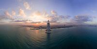Panoramic aerial view of the luxurious Burj Al Arab Hotel in the bay of Dubai.