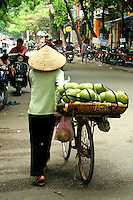 Fruit Vendors, Hanoi Old Quarter - near Hoan Kiem lake, has the original street layout and architecture of old Hanoi. At the beginning of the 20th century the entire city consisted of only about 36 streets, most of which are now the old quarter. Each street had merchants and artisans specialized in a particular trade such as silk, jewellery, coffee and herbalists. The street names reflect these specializations, although few of them remain exclusively in their original commerce.