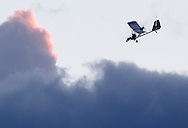 Pilot Rob Whiting comes in for a landing at Randall Airport after towing a hang glider in his Dragonfly aero-tug on Friday, Aug. 23, 2013.