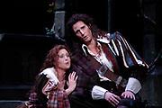 Miami -- Mar. 18, 2005 -- Florida Grand Opera production of Gaetano DonizettiÕs 1835 masterpiece Lucia di Lammermoor. Act I. Scene 2. A ruined fountain in Ravenswood Castle Park at dawn. Lucia played by Leah Hunt and Edgardo Ravenswood played by James Valenti secretly exchange marriage vows.(El Nuevo Herald Photo/Gaston De Cardenas)