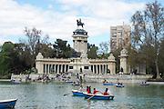 Madrid, Spain, Boating lake in Buen Retiro park. King Alfonso XII memorial in the background