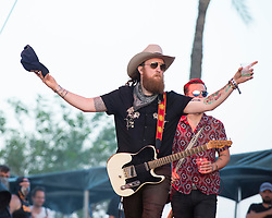 April 28, 2018 - Indio, CA, U.S. - INDIO, CA - APRIL 28:  John Osborne of the Brothers Osborne makes his way onto the stage at Stagecoach, California's Country Music Festival on April 28, 2018 at the Empire Polo Club in Indio, CA. (Photo by Tom Walko/Icon Sportswire) (Credit Image: © Tom Walko/Icon SMI via ZUMA Press)