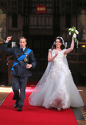 STRICT EMBARGO TO 00:01 FRIDAY 15 APRIL 2011© licensed to London News Pictures. LONDON, UK  12/04/11. The filming of a new T-Mobile advert in which Kate Middleton and Prince William lookalikes pretend to get married at a mock royal wedding. The filming took place at St Bartholomew the Great Church in London. All the main royal family members and the Arch Bishop of Canterbury were played by actors. The actors danced down the aisle with moves choreographed by Louie Spence. Please see special instructions. Please see special instructions. Photo credit should read LNP
