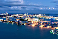 Aerial view  at night of the Miami Seaport, Miami Beach and Watson Island in Florida.