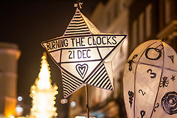 © Licensed to London News Pictures. 21/12/2016. Brighton, UK. Thousands of people take part in the 2018 Burning the Clocks  community event in Brighton and Hove. Participants parade through the city with paper lanterns. Photo credit: Hugo Michiels/LNP